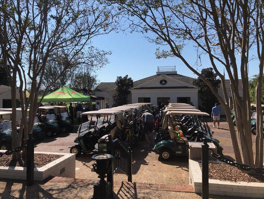 Overview of the golf carts and SERVPRO tent at the 14th Annual SERVPRO of Mississippi Golf Tournament